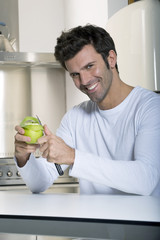 man peeling an apple