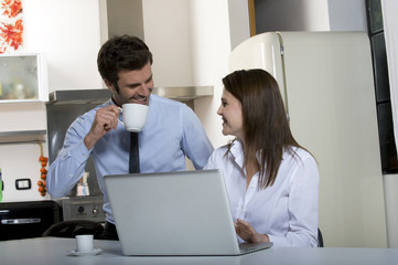 couple drinking coffee before going to work