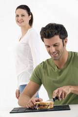 Couple  preparing a sandwich