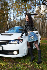 Brunette girl and stylish white car