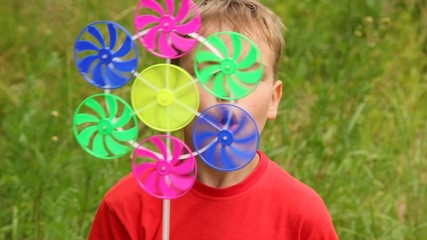 sunny summer day a boy is strongly blowing on the propellers