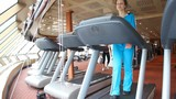 woman is exercising in gym