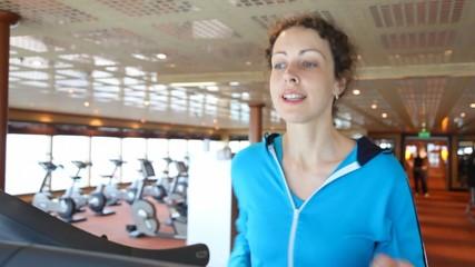 slim woman running in gym