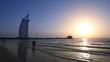 People on beach, sunset