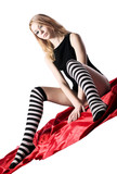 young beauty girl with naked buttocks and striped socks poster