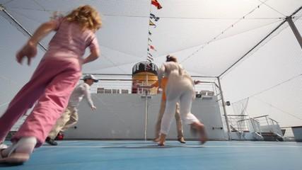 family playing basketball on cruise ship