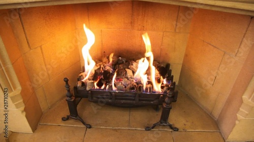close-up shot of flame in fireplace of brown room