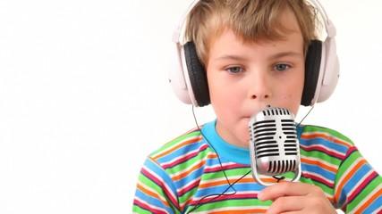 boy in earphones talking through microphone