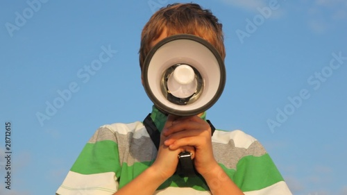 face of boy behind the megaphone
