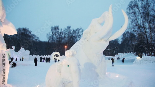 snow sculptures of mammoths at winter evening on snow town