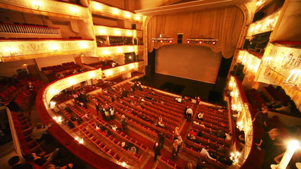 People in hall expect continuation after break of operetta