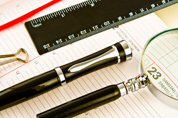 Pen on Agenda with a tools of punctuality