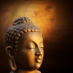 Head of Budha on golden background