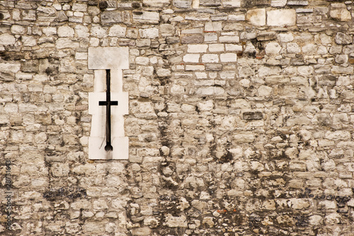 Medieval castle wall arrow slit background texture