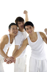 Asian happy university students over a white background