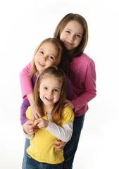 Three young sisters having fun
