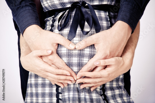 father and mother hands waiting for a baby