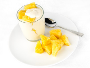 Pineapple yogurt with pineapple chunks