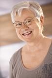 Portrait of happy female pensioner poster