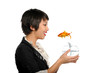 Asian young woman with gold fish