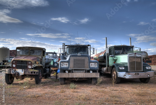 Plexiglas Oude auto s Three trucks on Junkyard