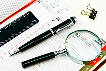 Pen and Agenda with a tools of punctuality