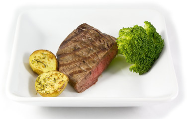 Steak dinner with potatos and broccoli