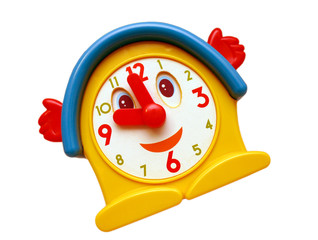 Smiling old toy clock