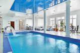 Indoor big blue swimming pool interior in modern minimalism styl
