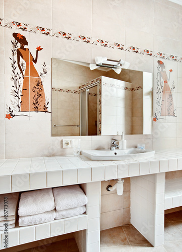 Part of modern bathroom interior with sink and mirror