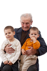Grandfather with his grandsons; isolated on white