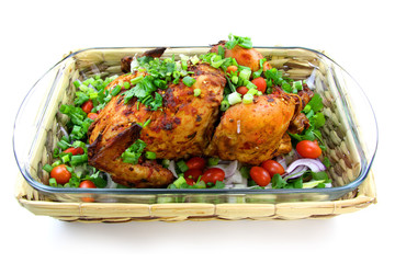 Baked whole chicken with green vegetables  isolated