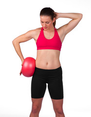 young woman exercise with red ball