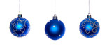 three blue hanging christmas balls isolated over white