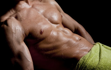 Wet Muscular Man Wrapped in a Towel