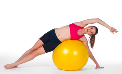 young woman exercise on pilates ball