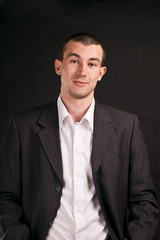 Adult businessman on a black background