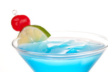 Blue Cosmopolitan cocktail with lime and cherry