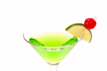 Green apple martini cocktail with lime and cherry