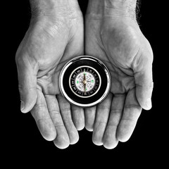 Compass in hands