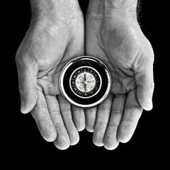 Compass in hands