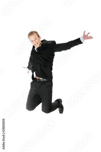 Young happy caucasian businessman jumping