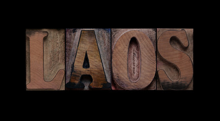 the word Laos in old letterpress wood type