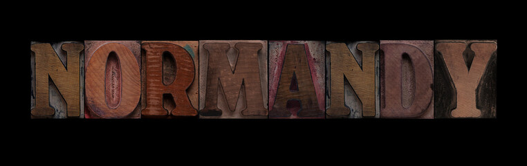 the word Normandy in old letterpress wood type