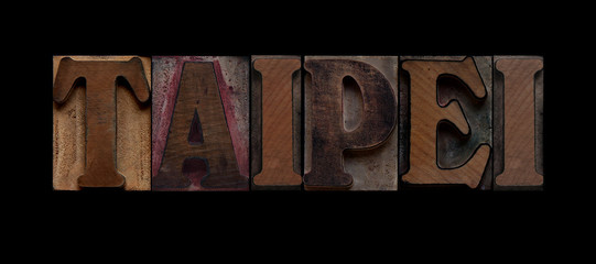 the word Taipei in old letterpress wood type