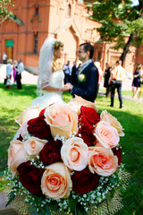 Вouquet of roses and couple on the background