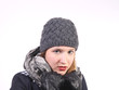 Young woman with grey woolen cap