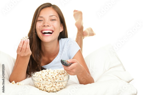 Woman watching funny movie laughing