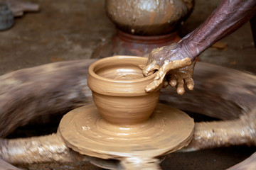 Potter's Hands Creating New Pot