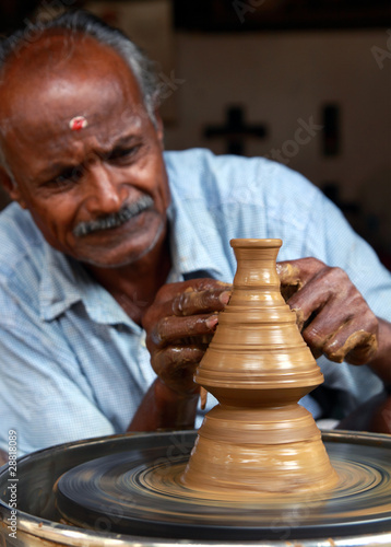 Indian Potter Making a New Pot
